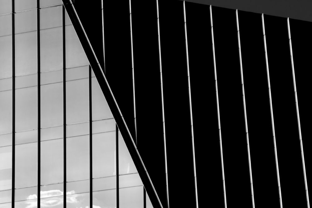 Black and white architecture building with glass and grey sky
