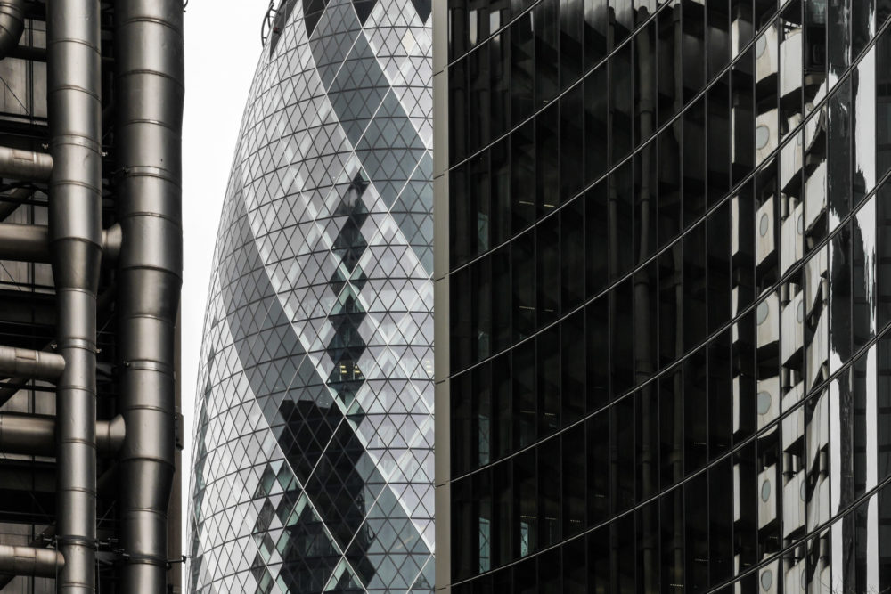 LONDON, UK - 8 MARCH 2015: Abstract architectural detail of key City of London financial landmarks including the iconic Gherkin building (centre) and Lloyds Building (left).